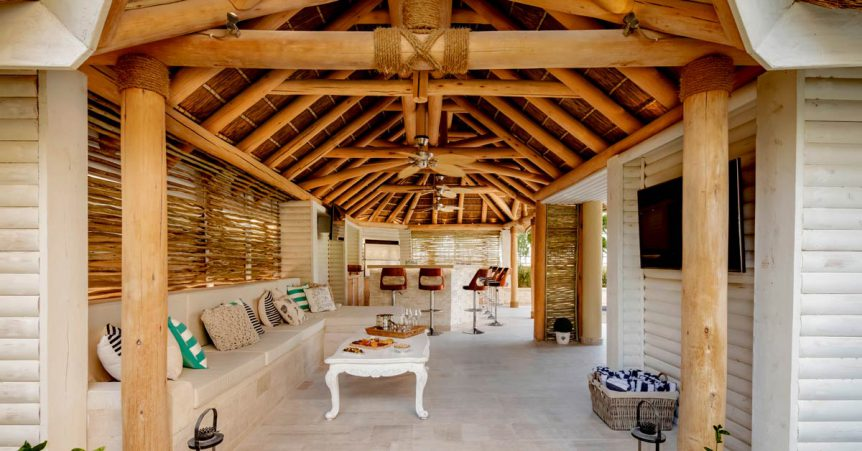 Thatched roof entertainment area with natural eucalyptus substructure