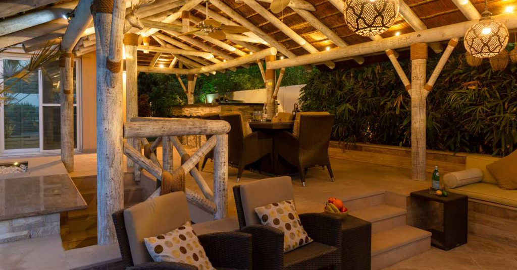 Sunken seating and dining area with a thatched gazebo