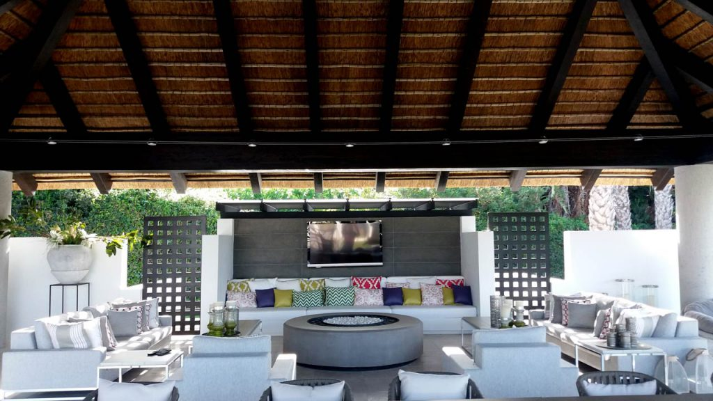 Thatched outdoor living space on square timber