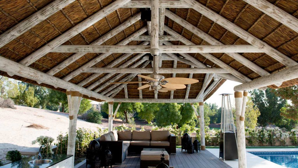 Residential thatched gazebo with a white washed timber finish