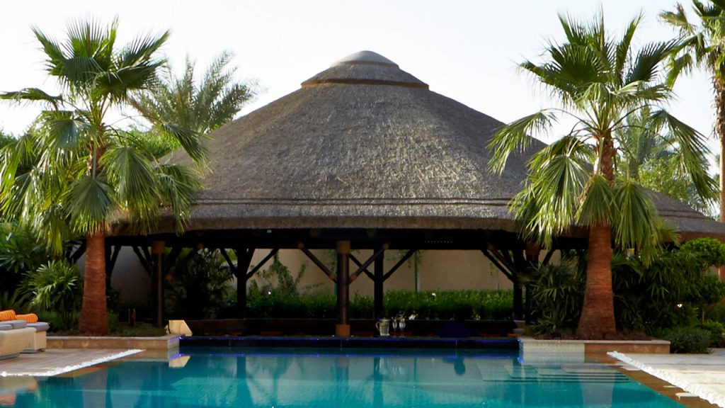 Sunken thatched gazebo with outdoor area