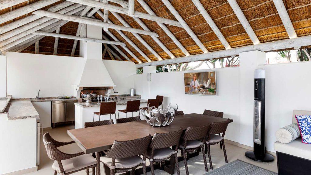 Poolside thatched gazebo interior in a whitewash finish