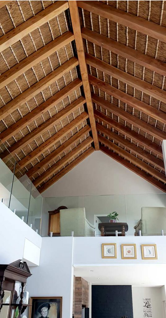 Cape Reed tribute project timber and thatched roof interior