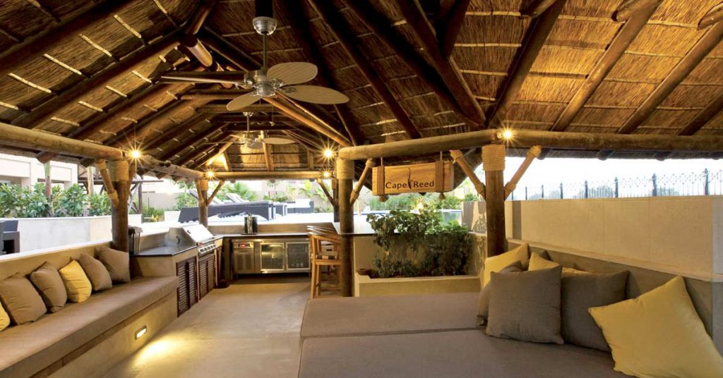 Customized thatched gazebo interior with kitchen