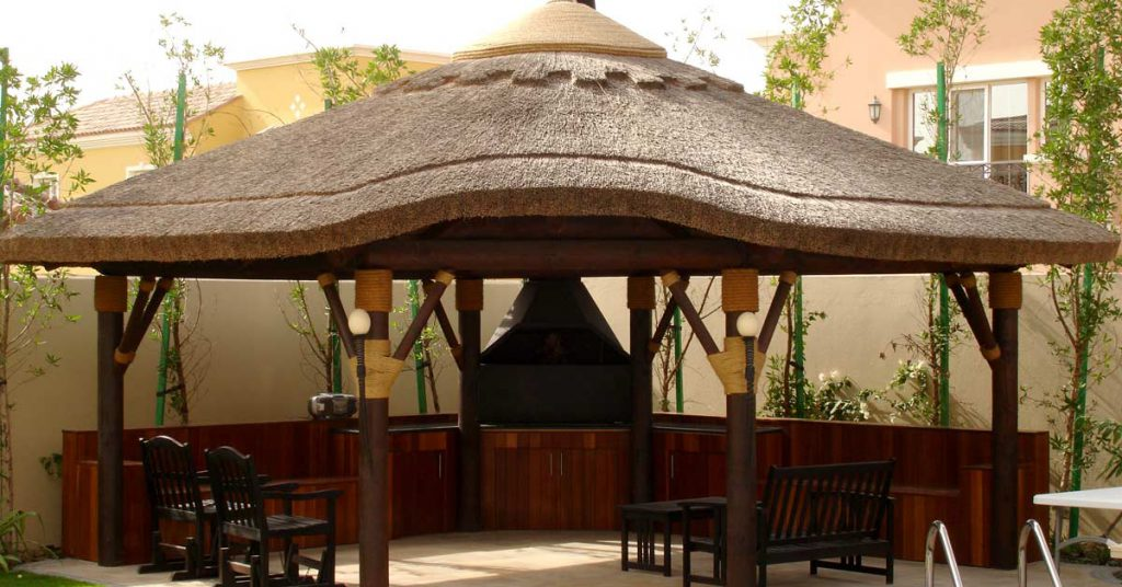 Thatched gazebo with outdoor bbq