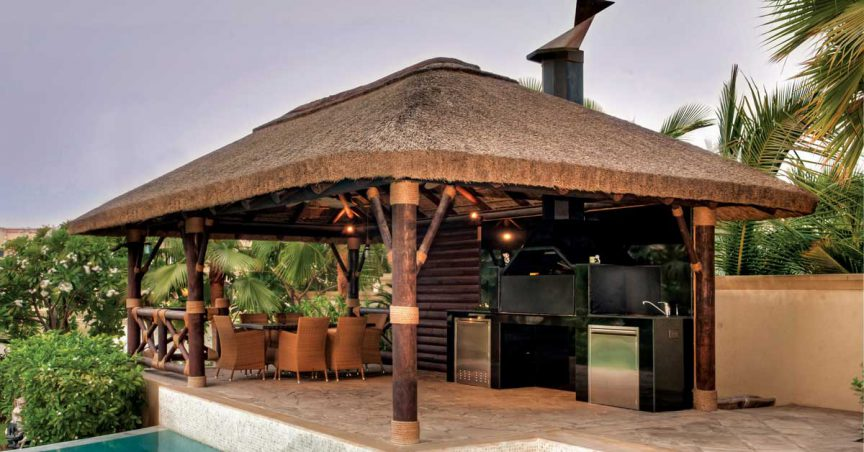 Thatched gazebo with timber cladding, buildt in braai and seating area
