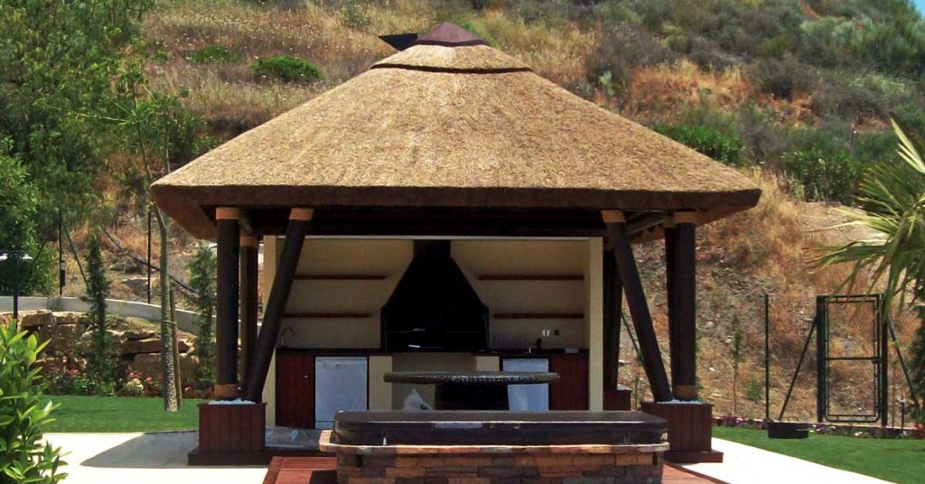 Outdoor thatched gazebo with built in BBQ area