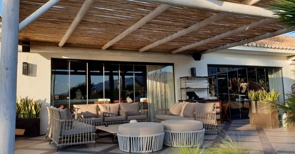 The Boho Club Marbella restaurant timber pergola over the terrace