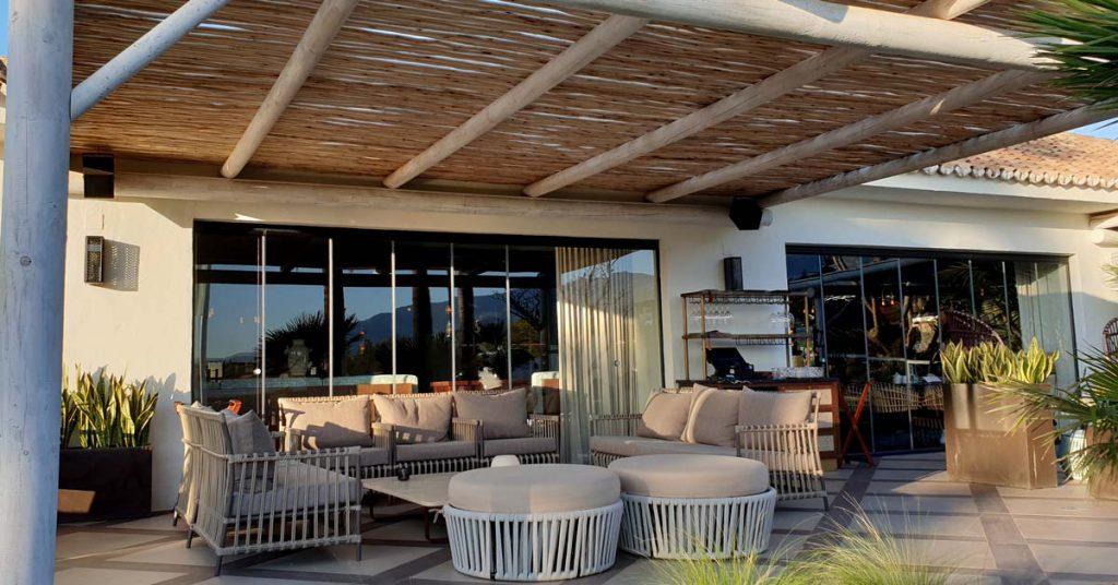The Boho Club Marbella restaurant timber pergola over the terrace