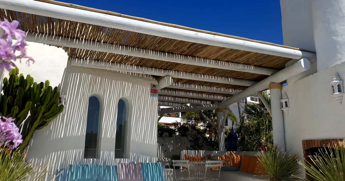 Cape Reed white-wash semi-shaded pergola with timber laths