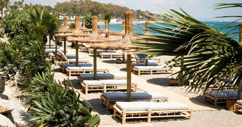Thatch sombrilla with sun loungers