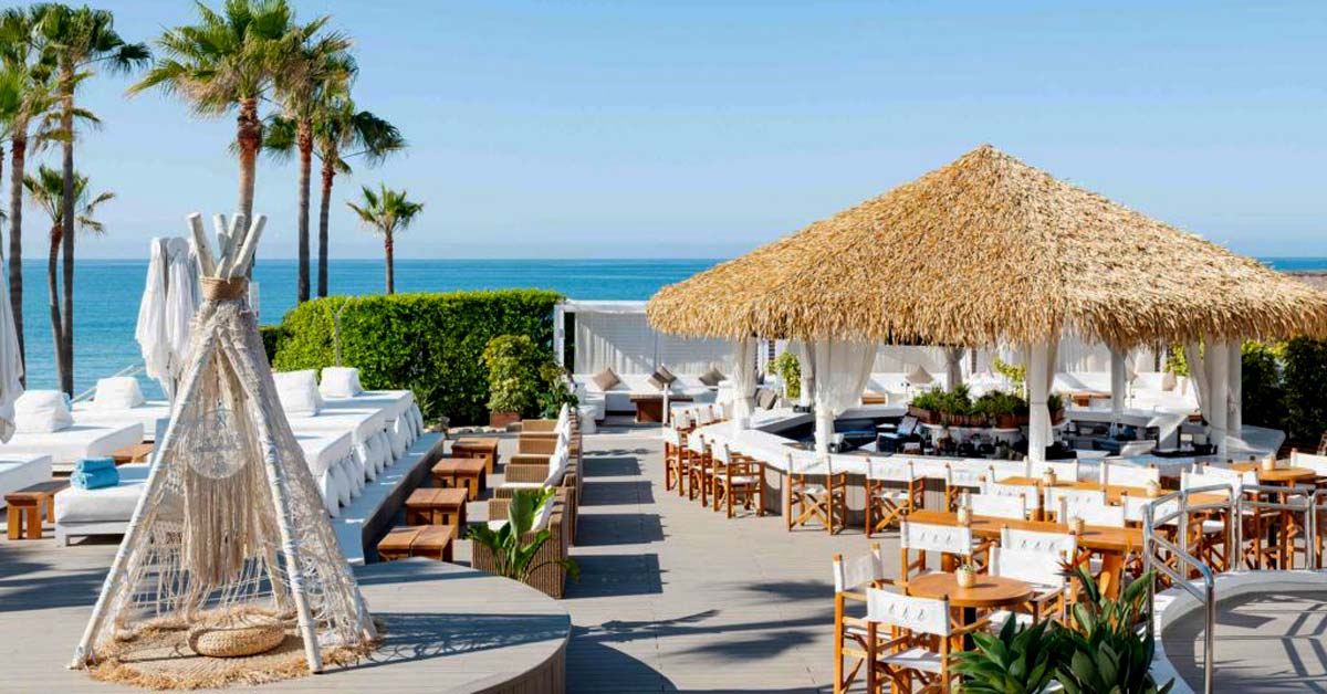 Cape Reed synthetic thatch Nikki Beach Marbella pool bar