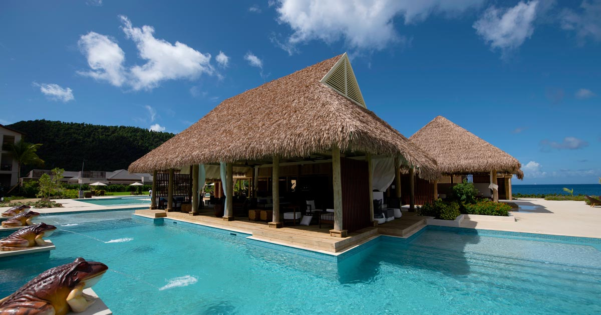 Cape Reed synthetic thatch roof Cabrits Resort Kempinski Dominica poolside villa with decking