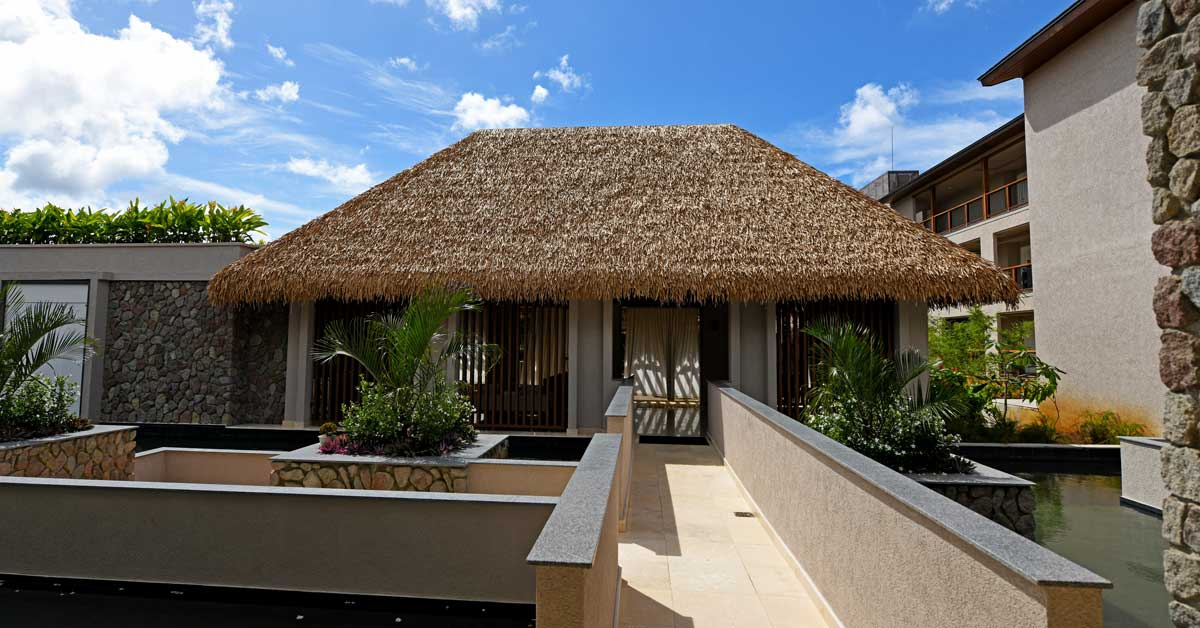 Cape Reed synthetic thatch roof chalet Cabrits Resort Kempinski Dominica
