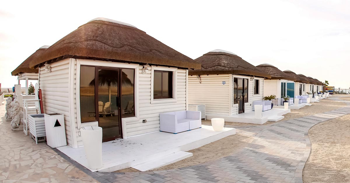 Cape Reed thatched cabanas with timber cladding in a whitewash finish