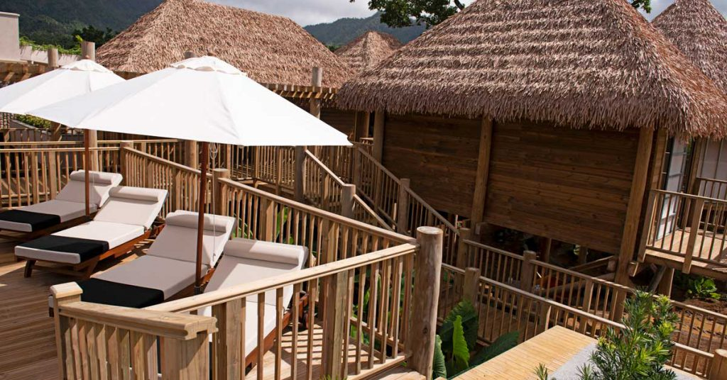 Cape Reed synthetic thatch chalets with timber decking and balustrades