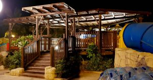 Timber construction elevated decking with steps, balustrades and pergola