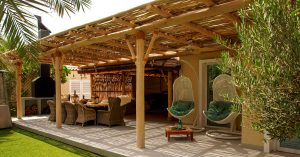 Cape Reed timber construction pergola with semi-shaded laths in Dubai