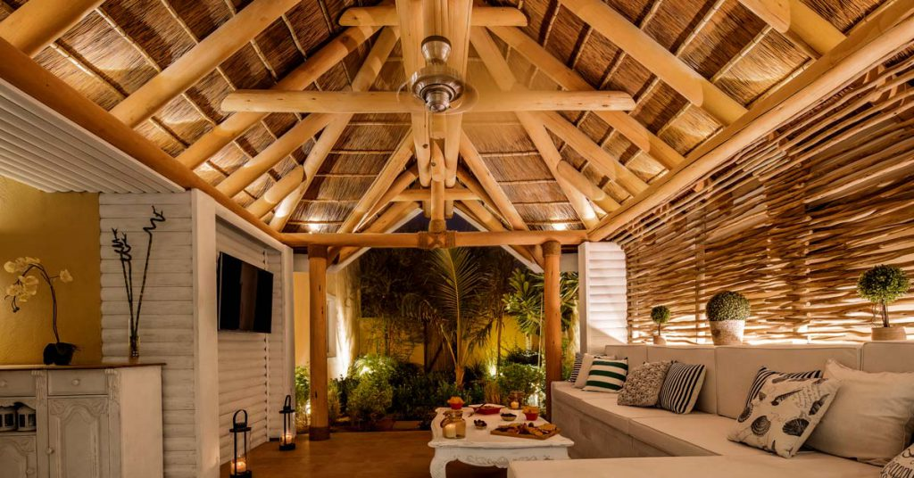 Cape Reed turnkey project private villa with thatched outdoor living area with timber cladding