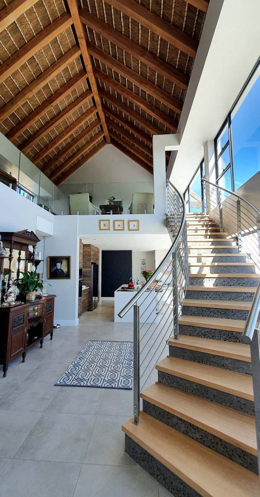 Cape Reed turnkey project residential thatched roof interior with square beams