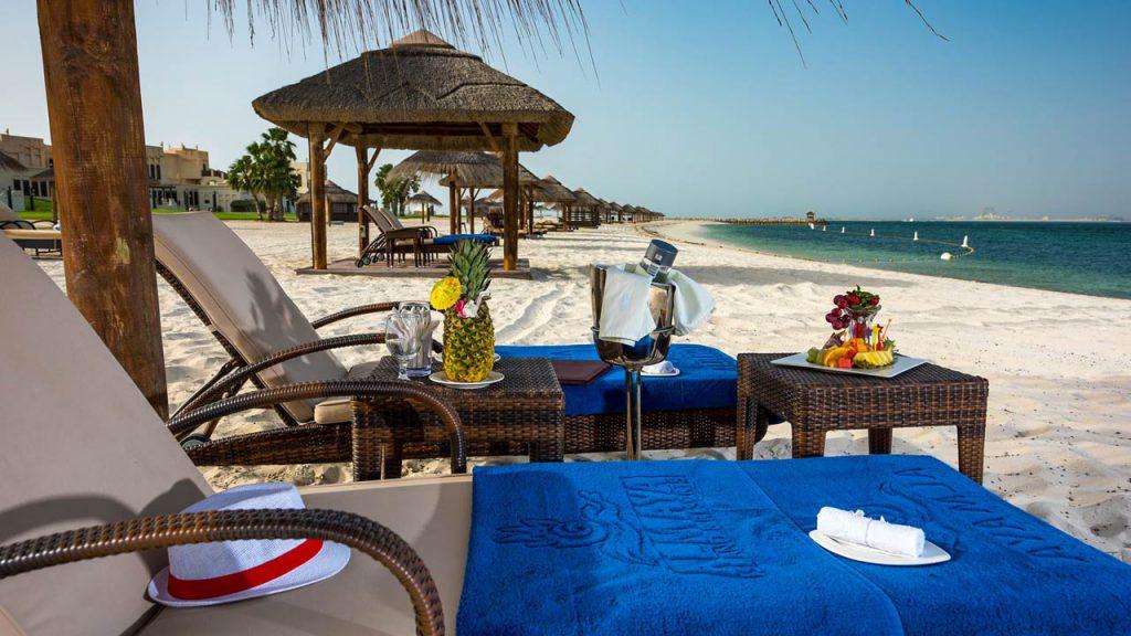 Thatched beach cabanas and umbrellas