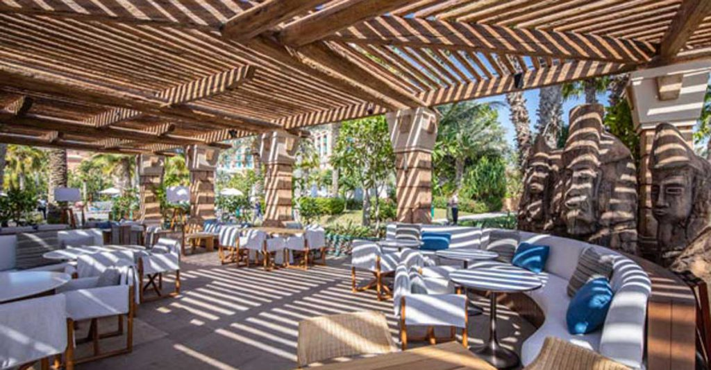 White Beach timber pergolas over seating area at the restaurant