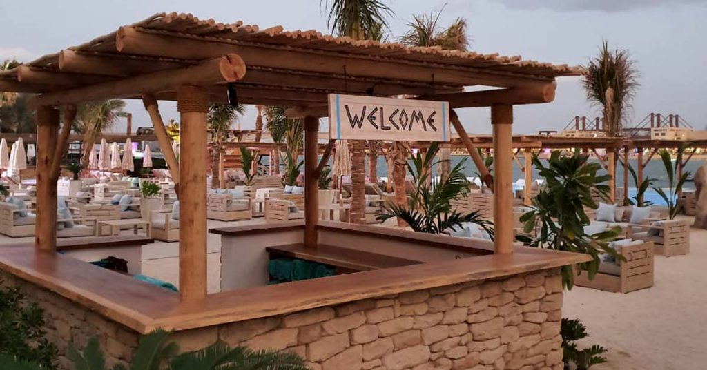 White Beach welcome desk with timber counter and pergola