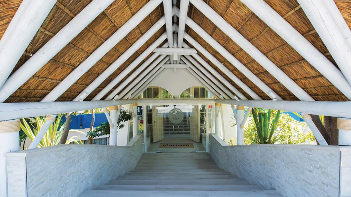 El Oceano beach restaurant white washed thatched roof entrance