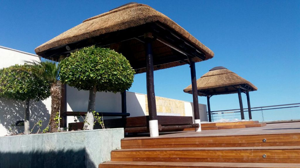 Penthouse thatched daybed cabanas and timber decking