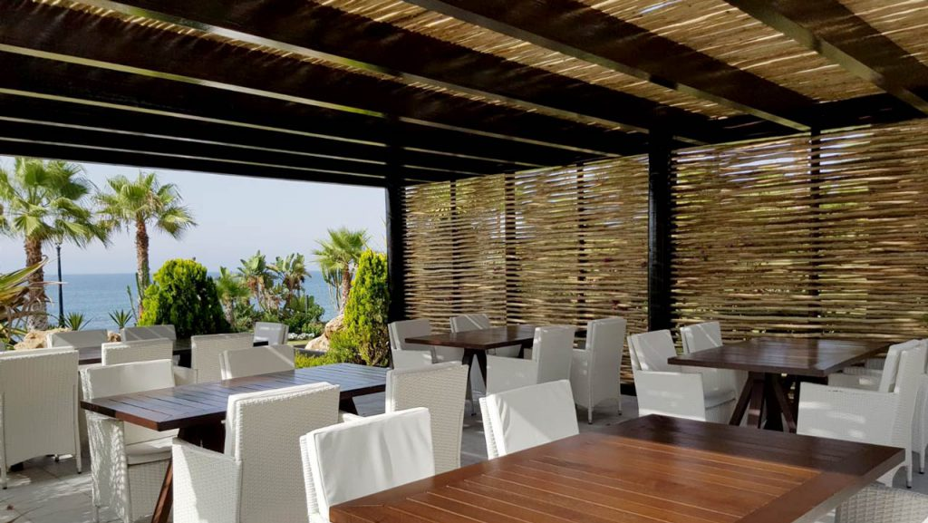 Las Dunas Park semi-shaded timber pergola seating area with woven lath screen