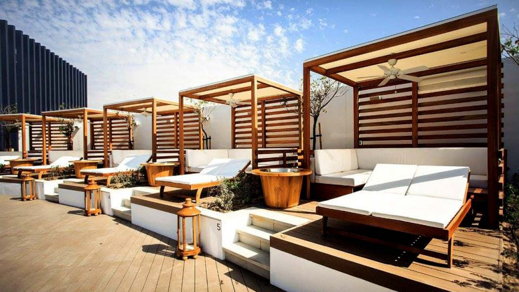 Timber daybeds at Nikki Beach Dubai