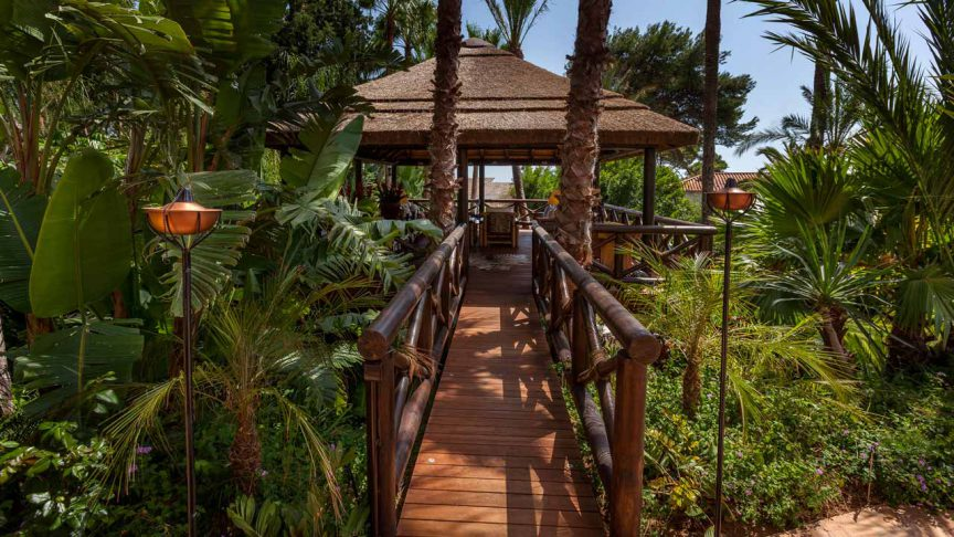 Elevated thatched gazebo with timber walkway decking and balustrades