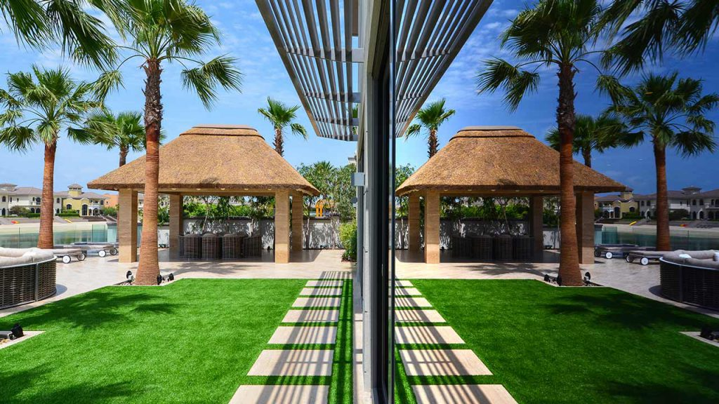 Thatched gazebo on concrete cladded columns and bearers