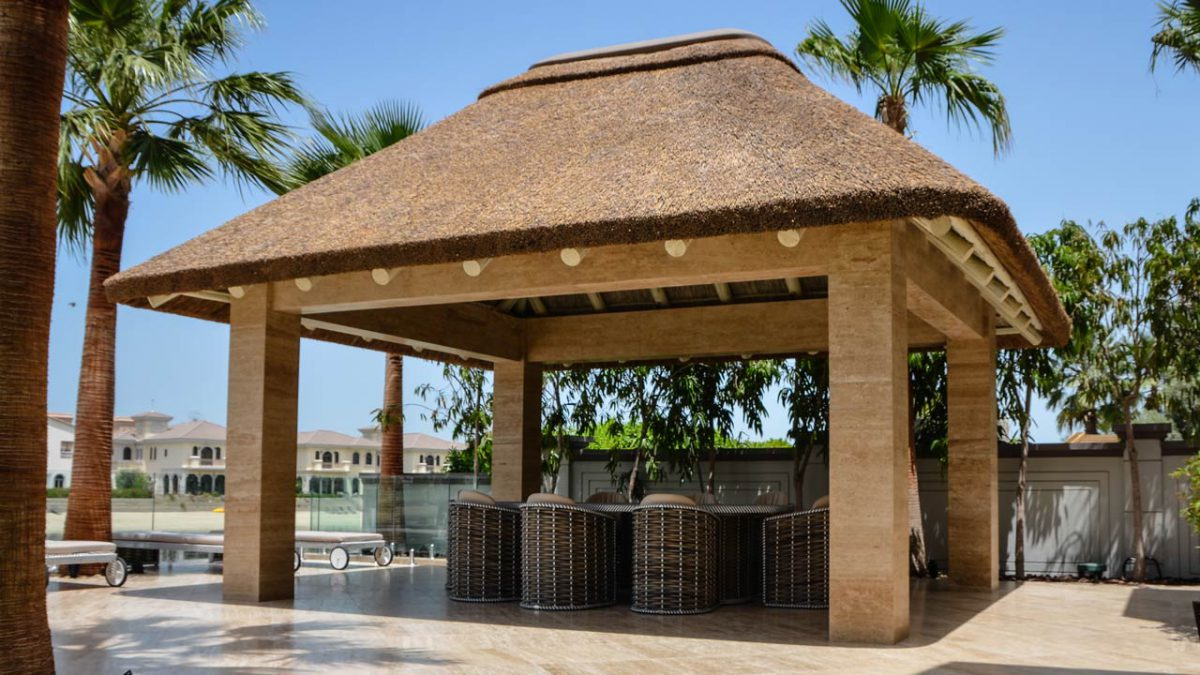 Thatched gazebo on concrete substructure