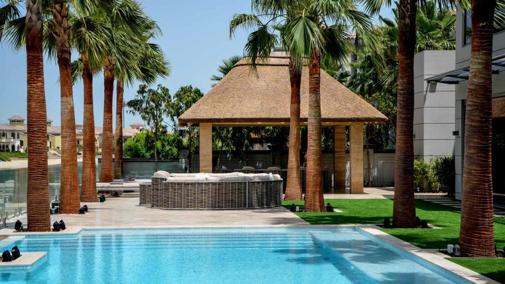 Thatched gazebo with outdoor seating area on the Palm Jumeirah