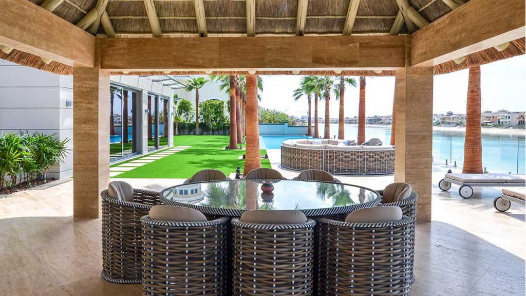Thatched gazebo with outdoor seating area