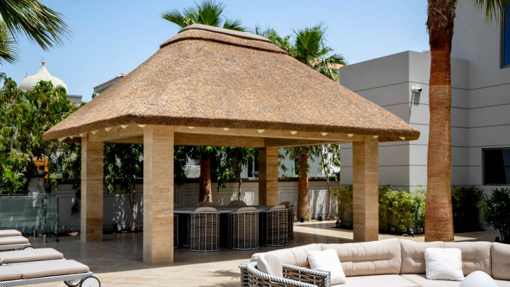 Thatched gazebo with seating area