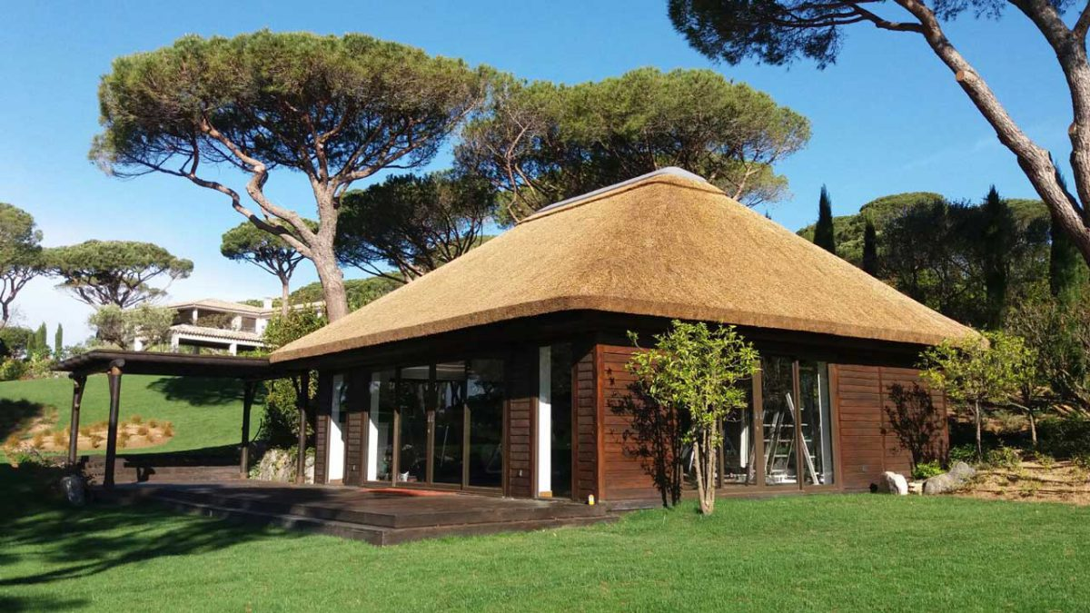 Thatched gymnasium cabin with timber cladding decking in St Tropez and pergola