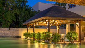 Thatched gazebo with outdoor lighting.
