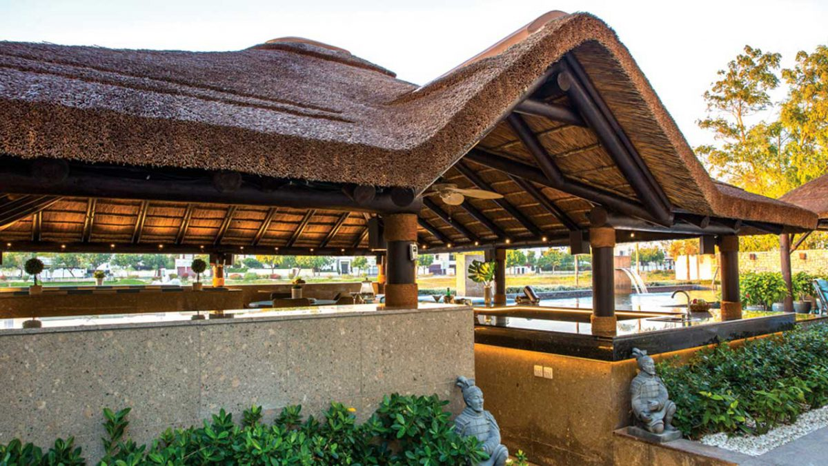 Thatched outdoor entertainment area with gabled entrance