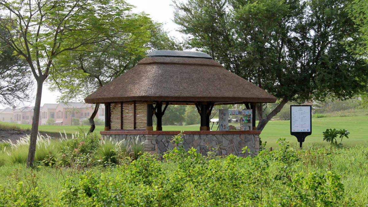 Thatched halfway house with lath screen