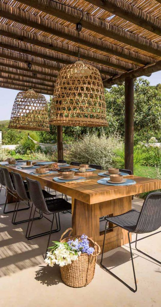 Timber pergola with decor and dining area