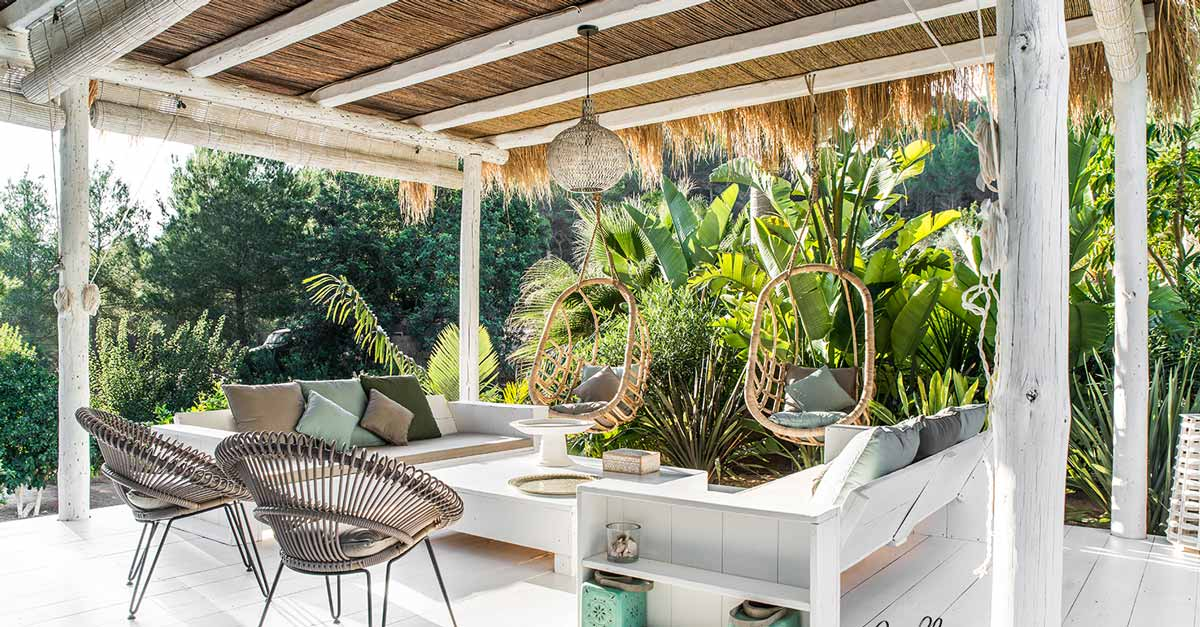 A Whitewashed Pergola with Seating