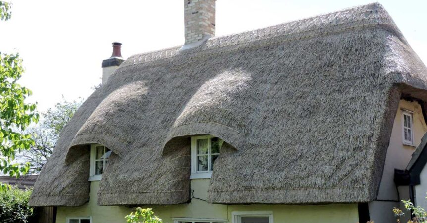 Long straw thatched roof cottage
