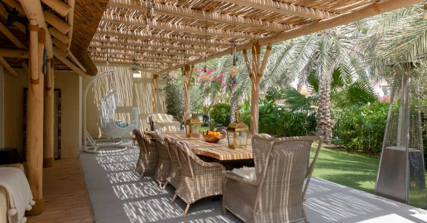 Idyllic backyard oasis with eucalyptus timber pergola