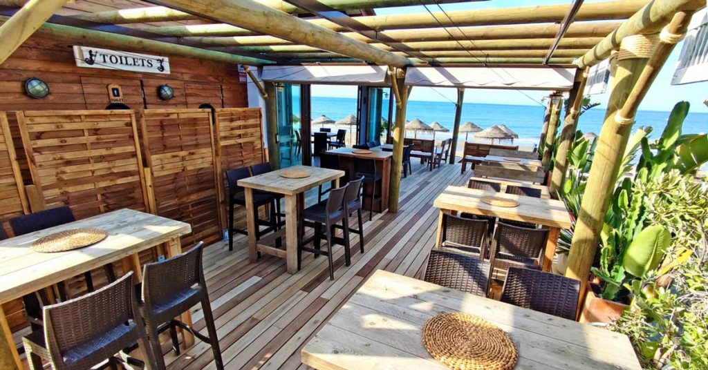 The terrace with timber decking and pergola